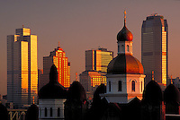 The towers of St John the Baptist Ukrainian Catholic Church, South side contrast to the modern skyscrapers in the background. Pittsburgh Pennsylvania United States Southside skyline.