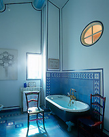 This double-height bathroom has been decorated in a cool blue