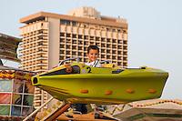 Tripoli, Libya, North Africa - Libyan Boy on Amusement Park Ride.
