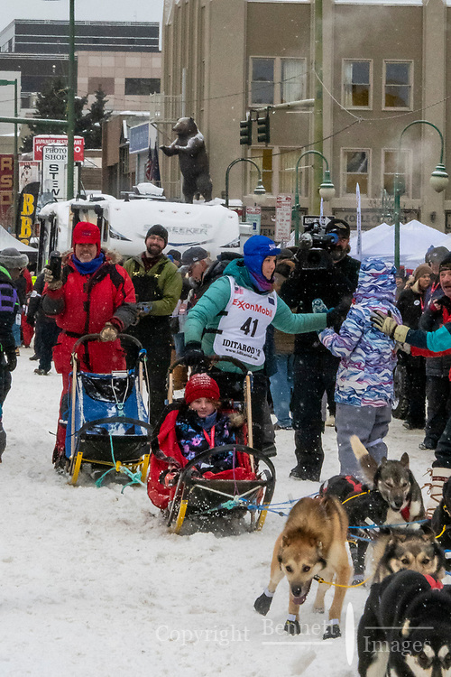 Jessica Klejka and team leave the ceremonial start line with an Iditarider and handler at 4th Avenue and D street in downtown Anchorage, Alaska on Saturday March 7th during the 2020 Iditarod race. Photo copyright by Cathy Hart Photography.com