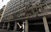 Pictured: A man throws a brick to the ministry building which has already has many smashed windows Friday 12 February 2016<br /> Re: Violent clashes between farmers and riot police outside the Ministry of Agricultural Development in Athens, Greece. The farmers travelled from Crete to protest against pension and welfrae reforms proposed by the Greek government,