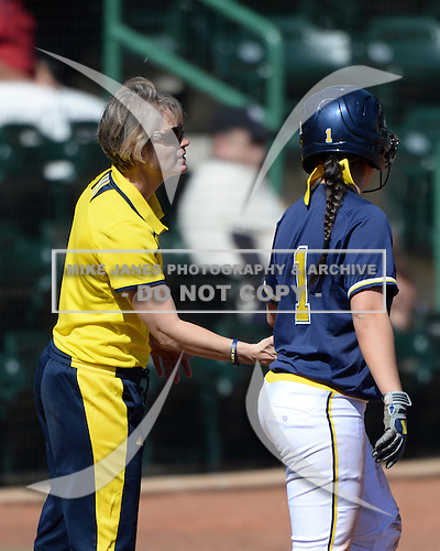 Michigan Wolverines Softball coach Bonnie Tholl and infielder Abby Ramirez (1) during a game against the Bethune-Cookman on February 9, 2014 at the USF Softball Stadium in Tampa, Florida.  Michigan defeated Bethune-Cookman 12-1.  (Copyright Mike Janes Photography)