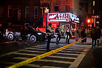 BROOKLYN, NY — SEPTEMBER 25, 2020:  NYPD detectives investigate at the scene of a double shooting, where one man was killed and another seriously injured while sitting in a Jeep Cherokee, on the corner of Marcus Garvey Blvd and Monroe Street early in the morning on September 26, 2020 in the Brooklyn borough of New York City.  Photograph by Michael Nagle