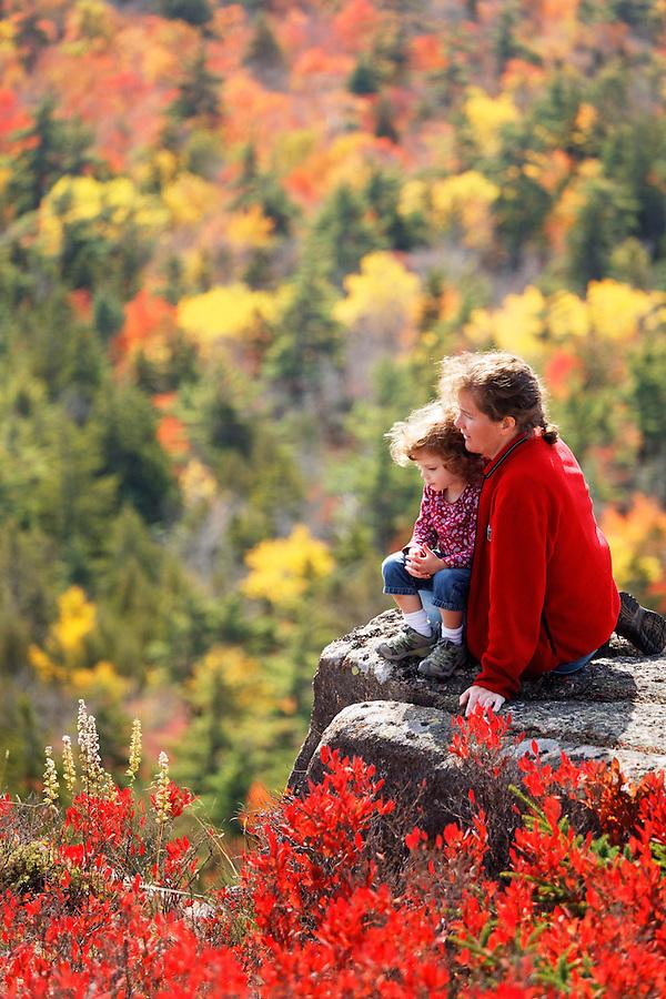 Woman and little girl enjoying fall colored landscape, Mount Desert Island, Acadia National Park, near Bar Harbor, Maine, USA
