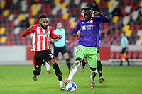 Rico Henry of Brentford and Bristol City's Famara Diedhiou challenge for the ball during Brentford vs Bristol City, Sky Bet EFL Championship Football at the Brentford Community Stadium on 3rd February 2021