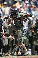 Vanderbilt Commodores third baseman Austin Martin (16) celebrates at the plate after his leadoff home run in Game 3 of the NCAA College World Series against the Louisville Cardinals on June 16, 2019 at TD Ameritrade Park in Omaha, Nebraska. Vanderbilt defeated Louisville 3-1. (Andrew Woolley/Four Seam Images)