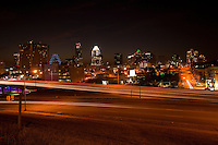 The late fall skyline of Austin, shows sunset looking northwest toward downtown, with Interstate 35 in the foreground. Austin, Texas has received its share of publicity lately as a growing city of the Southwest that has weathered the two-year economic downturn.
