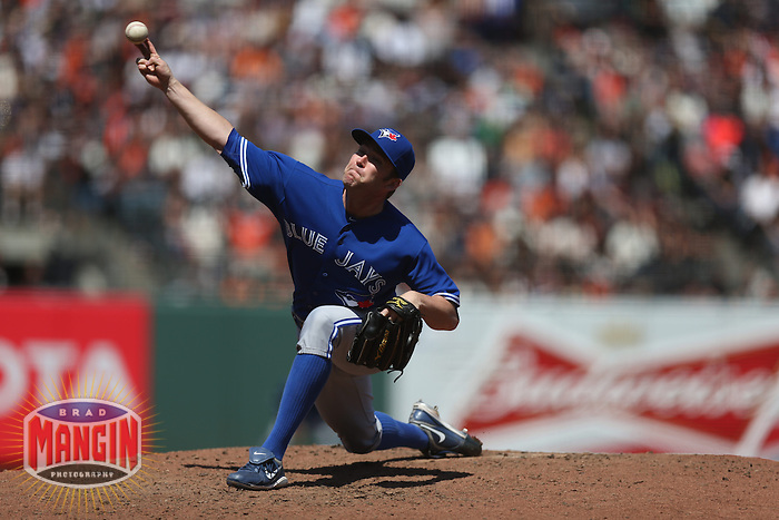 SAN FRANCISCO, CA - JUNE 5:  Casey Janssen #44 of the Toronto Blue Jays pitches against the San Francisco Giants during the game at AT&T Park on Wednesday, June 5, 2013 in San Francisco, California. Photo by Brad Mangin