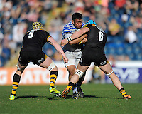 Mako Vunipola of Saracens is tackled by Kearnan Myall and James Haskell of London Wasps during the Aviva Premiership match between London Wasps and Saracens at Adams Park on Saturday 29th March 2014 (Photo by Rob Munro)
