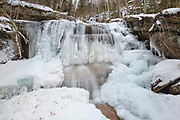 Champney Falls in Albany, New Hampshire during the winter months. This waterfall is along Champney Falls Trail, near Pitcher Falls.