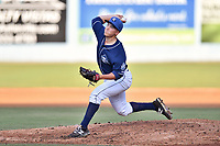 Asheville Tourists relief pitcher Matt Dennis (30) delivers a pitch during a game against the Augusta GreenJackets at McCormick Field on July 15, 2017 in Asheville, North Carolina. The Tourists defeated the GreenJackets 2-1. (Tony Farlow/Four Seam Images)
