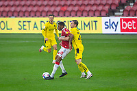 3rd October 2020; Riverside Stadium, Middlesbrough, Cleveland, England; English Football League Championship Football, Middlesbrough versus Barnsley; Chuba Akpom of Middlesbrough FC is challenged by Michael Sollbauer of Barnsley FC
