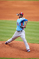 Tennessee Smokies pitcher Felix Pena (34) delivers a pitch during a game against the Montgomery Biscuits on May 25, 2015 at Riverwalk Stadium in Montgomery, Alabama.  Tennessee defeated Montgomery 6-3 as the game was called after eight innings due to rain.  (Mike Janes/Four Seam Images)