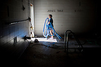 """A member removes hoses from a pool area during """"Circle the City with Service,"""" the Kiwanis Circle K International's 2015 Large Scale Service Project, on Wednesday, June 24, 2015, at the Friendship Westside Center for Excellence in Indianapolis. (Photo by James Brosher)"""