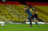 26th December 2020; Vicarage Road, Watford, Hertfordshire, England; English Football League Championship Football, Watford versus Norwich City; Jeremy Ngakia of Watford competes for the ball with Emi Buendia of Norwich City