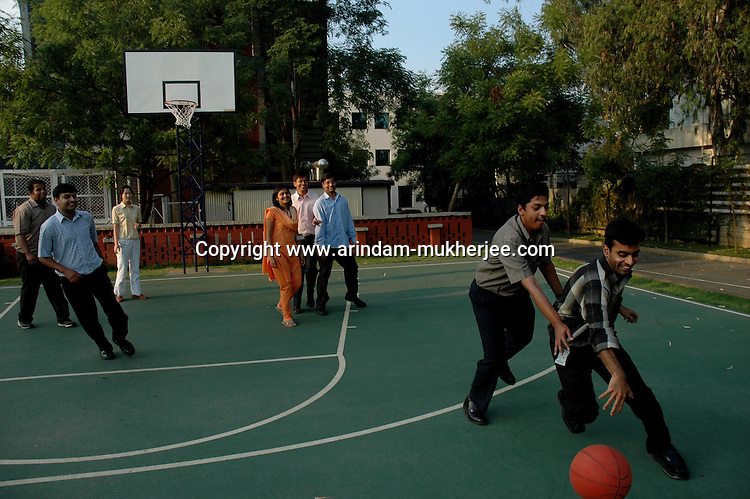 Indian software professionals playing basket ball at Infosys campus in Bangalore. Infosys is the largest software company in the country and the head office is in Bangalore, Karnataka, India. Arindam Mukherjee