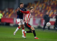 9th January 2021; Brentford Community Stadium, London, England; English FA Cup Football, Brentford FC versus Middlesbrough; Marcus Browne of Middlesbrough held off by Mads Roerslev of Brentford