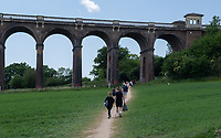 SURREY, ENGLAND. 25.05.2020<br /> .<br /> People head for the Viaduct to enjoy the sun during the bank holiday Monday Covid-19 lockdown with government guidelines to social distance  at OUSE RIVER VALLEY VIADUCT, England at  on 25 May 2020. Photo by Alan Stanford.