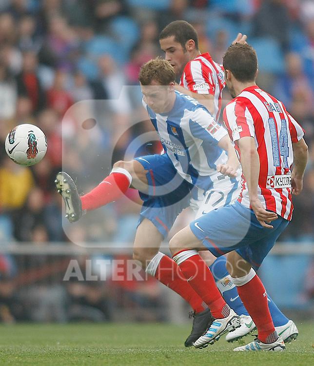 Atletico de Madrid's Alvaro Dominguez (l) and Gabi Fernandez (r) and Real Sociedad's David Zurutuza during La Liga match.Mayo 2,2012. (ALTERPHOTOS/Alconada)
