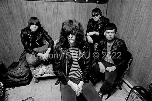 """Denver, Colorado<br /> USA<br /> May 9, 1983<br /> <br /> Back stage with the Ramones - singer: Joey Ramone (center), lead guitar: Johnny Ramone (left), basist: Dee Dee Ramone (right) and drummer: Tommy Ramone (back right). <br /> <br /> The Ramones were an American rock band that formed in Forest Hills, Queens, New York in 1974, often cited as the first punk rock group. Despite achieving only limited commercial success, the band was a major influence on the punk rock movement both in the United States and the United Kingdom.<br /> <br /> All of the band members adopted pseudonyms ending with the surname """"Ramone"""", though none of them were actually related. They performed 2,263 concerts, touring virtually nonstop for 22 years. In 1996, after a tour with the Lollapalooza music festival, the band played a farewell show and disbanded<br /> <br /> By a little more than eight years after the breakup, the band's three founding members--lead singer Joey Ramone, guitarist Johnny Ramone, and bassist Dee Dee Ramone--had all died."""