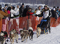 Sunday, March 4, 2012  Kristy Berrington high fives spectators in the starting chute during the restart of Iditarod 2012 in Willow, Alaska.