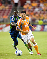 Houston Dynamo forward Brian Ching (25) attempts to hold off Seattle Sounders defender Jhon Kennedy Hurtado (34).  Houston Dynamo tied Seattle Sounders 1-1 on August 23, 2009 at Robertson Stadium in Houston, TX.