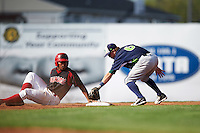 Vermont Lake Monsters second baseman Trace Loehr (6) puts the tag on Stone Garrett (11) sliding into second in during a game against the Batavia Muckdogs August 9, 2015 at Dwyer Stadium in Batavia, New York.  Vermont defeated Batavia 11-5.  (Mike Janes/Four Seam Images)