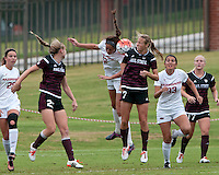 NWA Democrat-Gazette/BEN GOFF @NWABENGOFF<br /> Claire Kelley of Arkansas and Mallory Eubanks of Mississippi State jump for a header on Sunday Sept. 20, 2015 during the match at Razorback Field in Fayetteville.