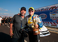 Sep 2, 2019; Clermont, IN, USA; NHRA funny car driver John Force celebrates with photographer Gary Nastase after winning the US Nationals at Lucas Oil Raceway. Mandatory Credit: Mark J. Rebilas-USA TODAY Sports