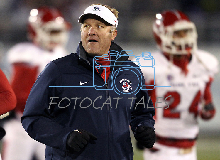 Fresno State's coach Tim DeRuyter runs to the sidelines before the first half of an NCAA college football game in Reno, Nev., on Saturday, Nov. 10, 2012. (AP Photo/Cathleen Allison)