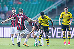 Borussia Dortmund Forward Alexander Isak (C) fights for the ball with AC Milan Midfielder Jose Mauri (L) during the International Champions Cup 2017 match between AC Milan vs Borussia Dortmund at University Town Sports Centre Stadium on July 18, 2017 in Guangzhou, China. Photo by Marcio Rodrigo Machado / Power Sport Images