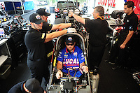 Aug. 5, 2011; Kent, WA, USA; Crew members for NHRA top fuel dragster driver Shawn Langdon during qualifying for the Northwest Nationals at Pacific Raceways. Mandatory Credit: Mark J. Rebilas-