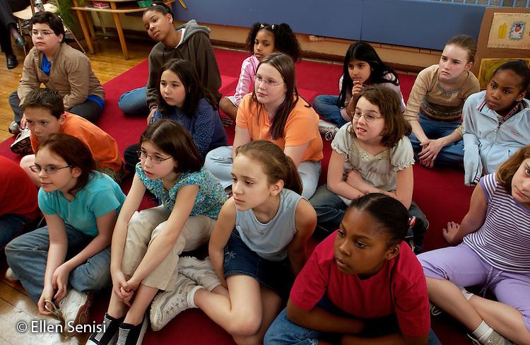 MR / Schenectady, NY.Yates Arts-in-Education Magnet School (urban elementary school) .Grade 4.Students listen in class..MR: g4m.© Ellen B. Senisi