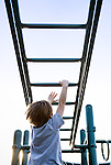 Conquering the monkey bars at school recess, originally shot for a healthcare annual report.