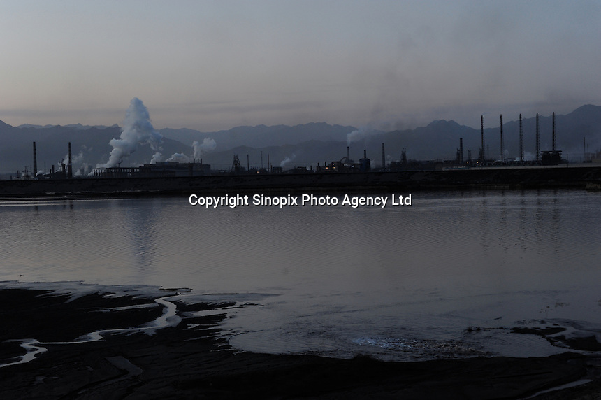 """The toxic Boagan """"tailing lake"""", is 11 sq km and the world's largest from """"rare earth"""" processing plants at Baotou, Inner Mongolia. China produces accounts for some 97% of rare earth consumed world-wide. The """"rare earth elements"""" are a group of 17 elements that are essential in 25% of modern technology including cell phones, computer hard discs, and electric motors and inparticular green technology such as electric batteries and wind turbines.."""