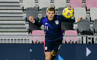 FORT LAUDERDALE, FL - DECEMBER 09: Chris Mueller #11of the United States heads a ball during a game between El Salvador and USMNT at Inter Miami CF Stadium on December 09, 2020 in Fort Lauderdale, Florida.