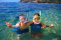 Two young boys (age 8) enjoy  spending the day exploring the coral reefs of Hanauma Bay, Oahu.;
