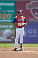 Pedro Castellanos (28) of the San Bernardos de Salem stands on second base after hitting a double against the Winston-Salem Dash at Haley Toyota Field on June 30, 2019 in Salem, Virginia. The Dash defeated the San Bernardos 3-2. (Brian Westerholt/Four Seam Images)
