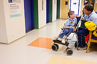 Jerry Jaminet and his son Nicholas at the Children's Hospital during the Share and Care Network's annual retreat held at the Doubletree Guest Suites Hotel in Boston on May 20, 2006. <br /> <br /> The Share and Care Network was created in 1981 by Pat Cahill when her son Scott was diagnosed with Cockayne Syndrome.  A rare form of dwarfism, Cockayne Syndrome is a genetically determined condition whose symptoms include microcephaly, mental retardation, progressive blindness, progressive hearing loss, premature aging, and a shortened lifespan averaging 18 years.  Those afflicted have distinctive facial features, including sunken eyes, pinched faces, and protruding jaws as well as distinctive gregarious, affectionate personalities.<br /> <br /> Because of the rarity of the condition (1/1,000 live births) and its late onset (characteristics usually begin to appear only after one year), many families and physicians are often baffled by children whose health begins to deteriorate after normal development.  It was partly with this in mind that the Share and Care Network was formed, to promote awareness of this disease as well as to provide a support network for those families affected.  In 1998 it began organizing an annual retreat, which has grown from three families in its inaugural year to more than 30 today.  Although the retreat takes place in the United States, families from as far as Japan arrive for this one weekend out of the year to share information and to support one another.