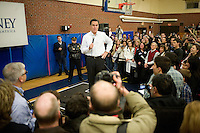 Former Massachusetts governor speaks to the crowd in the overflow area in a gymnasium at a Romney town hall campaign event at McKelvie Intermediate School in Bedford, New Hampshire, on Jan. 9, 2012.  Romney is seeking the 2012 Republican presidential nomination.