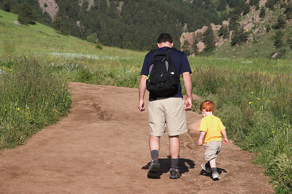 Caucasian father with son learning to walk, Front Range Mountains,  Boulder, Colorado, USA .  John leads private photo tours in Boulder and throughout Colorado. Year-round.