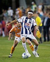 Pachuca FC midfielder Gabriel Caballero (8) dribbles away from Houston Dynamo defender Wade Barrett (24).  Houston Dynamo defeated Pachuca FC 2-0 in the semifinals of the Superliga 2008 tournament at Robertson Stadium in Houston, TX on July 29, 2008.