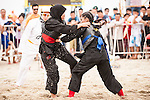 CHE OMAR Siti Zubaidah Che Omar of Malaysia (L) fights against SHAHRUDIN Nurhanishah of Singapore during the Pencak Silat Women's competition on Day Eight of the 5th Asian Beach Games 2016 at Bien Dong Park on 01 October 2016, in Danang, Vietnam. Photo by Marcio Machado / Power Sport Images