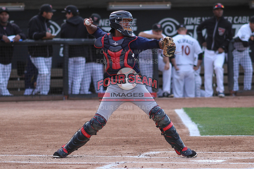 Cedar Rapids Kernels catcher Jorge Fernandez (32) throws down to second base between innings of a game against the Wisconsin Timber Rattlers on May 4th, 2015 at Fox Cities Stadium in Appleton, Wisconsin.  Cedar Rapids defeated Wisconsin 9-3.  (Brad Krause/Four Seam Images)