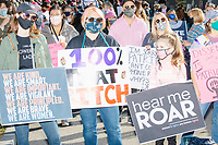 """A crowd gathers in Boston Common for the 2020 Women's March protest in opposition to the re-election of US president Donald Trump in Boston, Massachusetts, on Sat., Oct. 17, 2020.<br /> The signs here read """"We are kind / we are smart / we are important / we are vigilant / we are principled / we are brave / we are women,"""" """"100% that bitch,"""" """"Dissent is patriotic,"""" and """"hear me roar."""""""