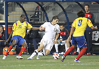 Eric Lichaj #13 of the USA MNT moves the ball between Adrian Ramos #20 and Falcao Garcia #9 of Colombia during an international friendly match at PPL Park, on October 12 2010 in Chester, PA. The game ended in a 0-0 tie.