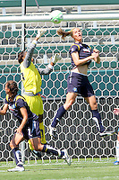 Karina LeBlanc #1 and Allison Falk #3 of the Los Angeles Sol leap to stop a shot against the Boston Breakers during thier WPS game at Home Depot Center on May 10, 2009 in Carson, California.