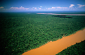 Brazil - Paraguay border. Aerial view of the rainforest canopy and the Paraguay river.