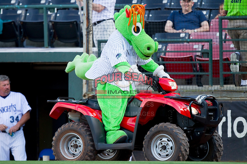 Charlotte Knights mascot Homer the Dragon makes his entrance riding a 4-wheeler during the International League game against the Gwinnett Braves at Knights Stadium on June 3, 2012 in Fort Mill, South Carolina.  The Braves defeated the Knights 5-1.  (Brian Westerholt/Four Seam Images)