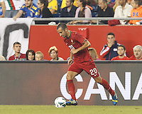 Portugal substitute midfielder Ruben Amorim (20) dribbles at midfield.  In an international friendly, Brazil (yellow/blue) defeated Portugal (red), 3-1, at Gillette Stadium on September 10, 2013.